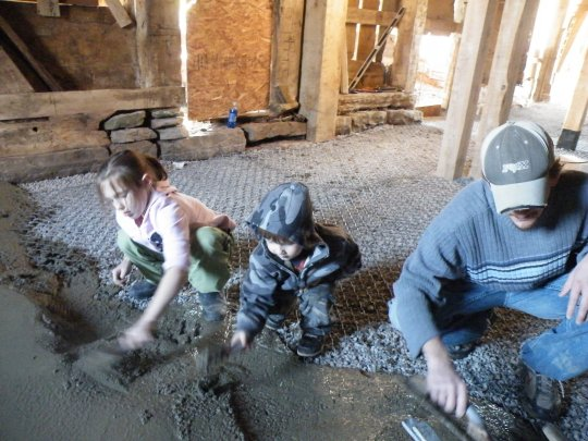 The Kids spreading cement. I'm the one on the right...